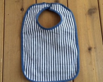 red, white and blue jean bib
