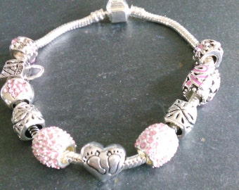 Bracelet trend, pink and Rhinestones, pendants, pearls watermarks, charms Family,