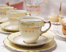 Very sweet buttermilk yellow gilded teaset with cute red polka dots: 1  tea cup, saucer and plate for that special occasion or a lovely gift