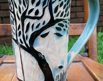 Tall Sgraffito Tree mug with swing
