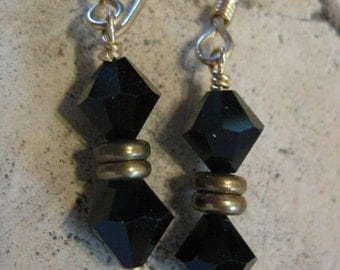 Faceted black glass and brass earrings