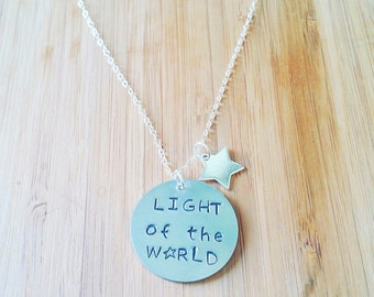 Light of the Word round pendant on a silver chain
