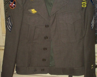 """World War II Uniform with """"Ike"""" Jacket, 2pants, patches and Medals"""