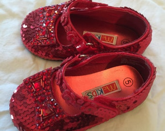 Infant sz 5 Sequin Ruby Slippers - New - for you mr little Dorothy.  Complete with sized replica bows!