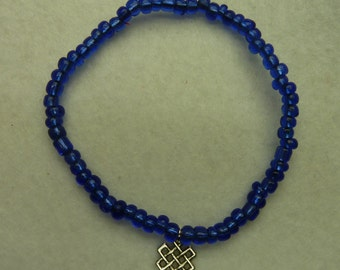 Bracelet with blue beads and silver pendant
