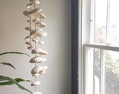 Mudpuppy Moon wind chimes organic hanging disc bells sculpture - natural buff stoneware