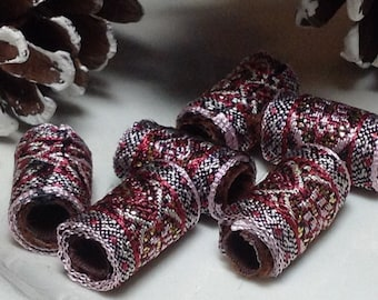 Classily woven in dark brown and pink. Non-traditional, yes. Christmassy absolutely!  Textile beads, Fiber Beads, Wide hole barrel tube