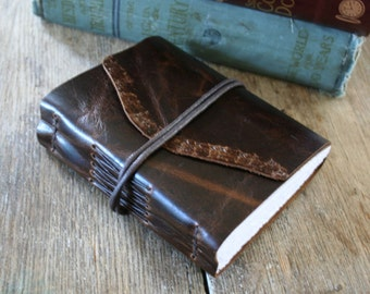 "Leather Journal . Anais Nin quote: ""We write to taste life twice, in the moment and in retrospect"" . handmade . ebossed (320 pgs)"
