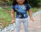 AG Bird print tee, grey animal print leggings, for 18 inch doll, modelled by American Girl