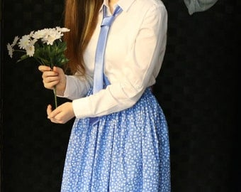 Girl's skirt, modest with dainty white daisies on a blue background