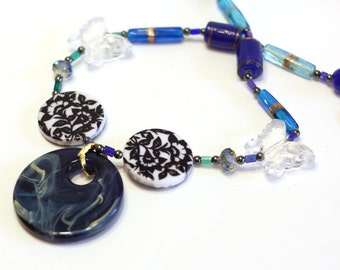 Blue, Black and White Handmade statement Necklace, Blue Marble Pendant with large butterfly beads, mixed beads necklace, hematite, crystal
