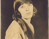 Beautiful Portrait of Roaring 20s Woman with Her Lips Slightly Pursed in a STYLISH ART DECO Pose Photo Circa 1920s