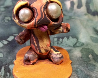 Lava I. Athon Monster made of magma, flaming hot creature,zombie like, cute,creepy,unique, fun collectable polymer clay sculpture