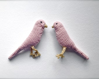 Pair of blush pink knitted canaries