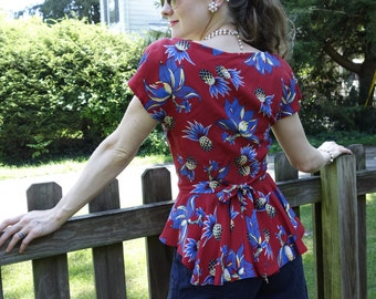 1940's Retro Hawaiian print button front blouse top flirty back peplum shoulder pads vintage reproduction blue pineapple print on red SML