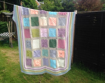 Patchwork crocheted granny blanket in muted tones
