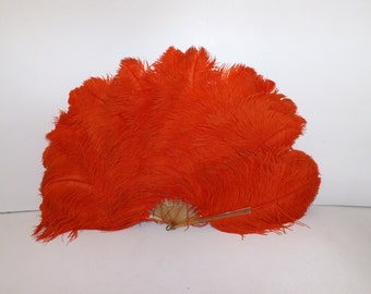 Vintage 1920s huge extra large flapper real orange ostrich feather hand fan with celluloid struts burlesque dancer