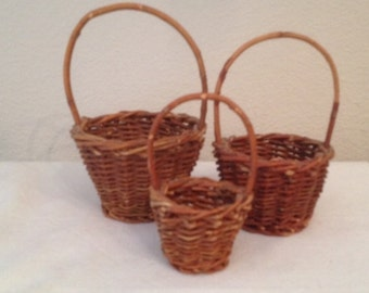 A Nest of Three Vintage Woven Twig Baskets