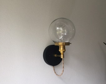 Frank • vintage industrial brass wall sconce with matte black canopy and clear glass globe