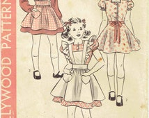 1940s Girl's Dress and Pinafore Pattern Hollywood 493: Dress with Puff Sleeves & Ruffled or Plain Pinafore with Heart Pockets. Size 8 Years