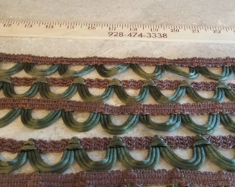 olive green and brown loop satin trim cord upholstery finish  5.49 a yard