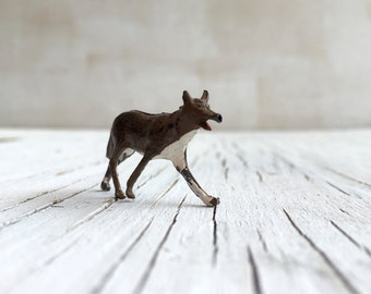 Vintage die cast toy fox. Britains or similar miniature metal die-cast toy fox. Circa 1930s.