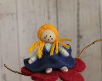 Thumbelina on a felt flower