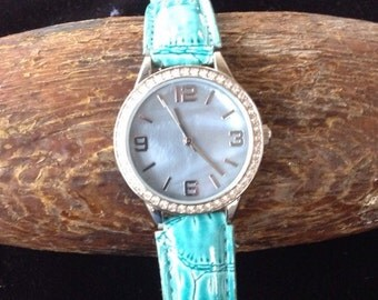 Ladies Crystal Bezel Watch with Periwinkle Face and Teal Leather Band (st - 1439)