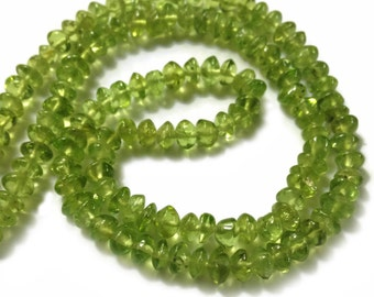 Peridot smooth rondelles.   Approx. 5-5.5mm.   Select a strand length.