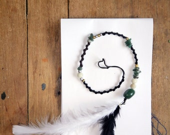 Bohemian hairbraid with green crystals and B&W feather