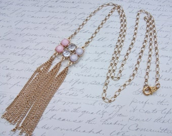 Long gold chain tassel necklace with pink and clear stones