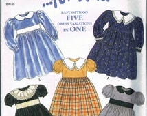 UNCUT Size 2-7 Girls High Waist Special Occasion Dress With Full Skirt & Puff Sleeves Sewing Pattern - New Look For Kids 6791