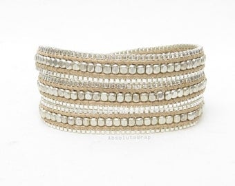 Triple wrap bracelet with silver plated beads and chain on soft beige polyester cord