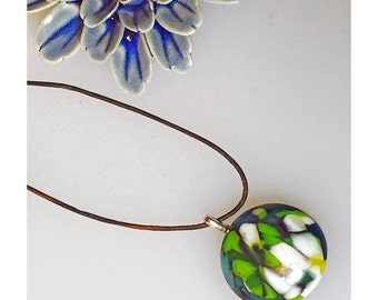Kiln fused round pendant on brown leather