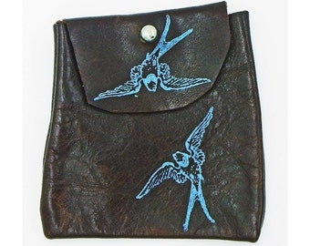 brown leather pouch with blue cranes in flight 2