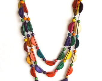 Brightly coloured coconut shell necklace, multicolored half moon semi-circles. Triple Three Loop Style With Closure.
