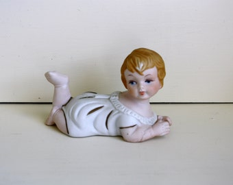 Bisque Porcelain Piano Baby Crawling Figurine