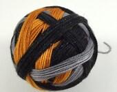 Ready to Ship: Campfire Tales - Hand Dyed Self-Striping Sock Yarn - Black, Grey, Gold