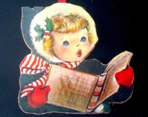 Girl Singing Carols Handcrafted Wooden Christmas Ornament, Green Wool Coat 1950s Christmas Card Red Mittens Striped Scarf Sunday School Gift