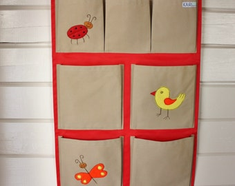 Kids organizer, hanging fabric pocket storage for books and toys