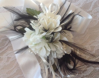 Wrist corsage White with black feathers for wedding, prom or formal.