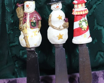 3 Vintage Boston Warehouse 2 Snowman Cheese Spreaders, 1 Lighthouse Cheese Spreader with a Holiday Wreath