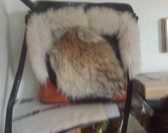 leather and fur handbag