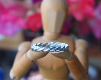 A gorgeously simple hand twisted solid sterling silver ring.