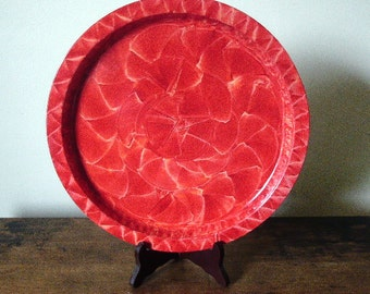 Round tray vinegar painted in red.