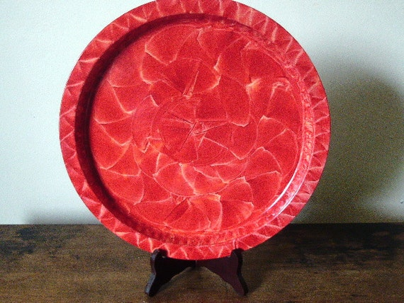 Tray vinegar painted in red.