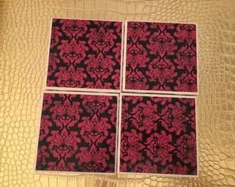 set of four handmade pink and black floral coasters