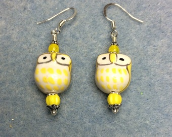 Yellow ceramic owl bead earrings adorned with yellow Czech glass beads.