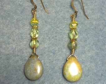 Yellow green Czech glass pear drop earrings adorned with yellow green Czech glass beads.