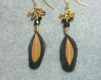 Black and brown pheasant feather earrings adorned with tiny dangling black and brown Czech glass beads.